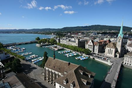 Zurich cityscape with famous landmarks and marina visible. Limmat River and Lake Zurich. Summertime panorama. photo