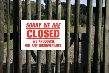 sorry: Closed wooden gate. Business shut down. Sorry notice.
