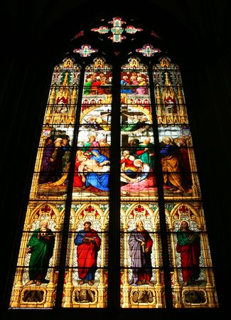 Cologne cathedral stained glass art depicting biblical stories and saints. The central motif is St. Mary holding Jesus Christ's body after crucifixion. Stock Photo - 4975656
