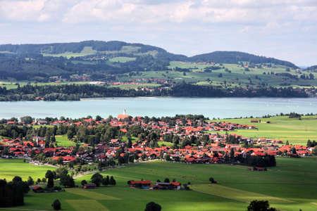 schwangau: Beautiful idyllic countryside landscape. Forgensee lake and two Bavarian towns: Waltenhofen and Schwangau. Stock Photo