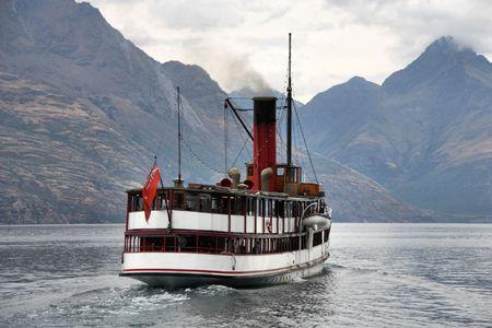 wakatipu: Vintage twin screw steamer - symbol of Lake Wakatipu and Queenstown in New Zealand. Rainy weather.
