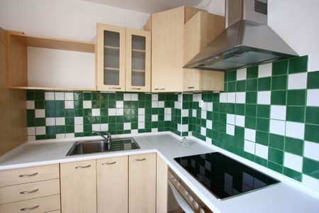 Modern kitchen - interior design. Green tiles, bright furniture.