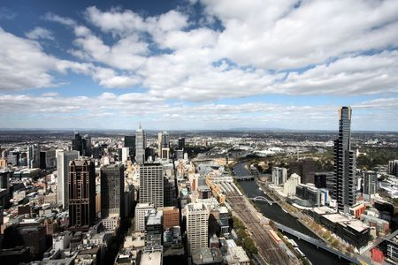 Beautiful cityscape of Melbourne and Yarra River. The prominent building is Eureka Tower, which is the worlds tallest residential tower when measured to its highest floor. photo
