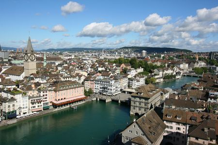 peters: Zurich cityscape. St. Peters Church tower with worlds largest church clock face. Swiss city. Aerial view.