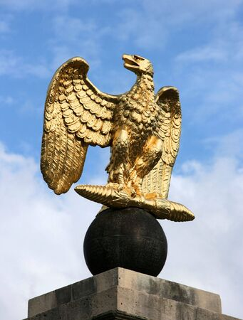 Eagle golden sculpture at the entrance to Fontainebleau castle in France. Chateau is inscribed to UNESCO world heritage list. photo