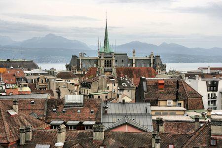 Old city on rainy day - Lausanne, Switzerland. Lake Geneva (Lac Leman), fountain and sailboats. photo