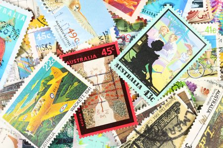 Diverse and colorful postage stamps from Australia. Old collection. photo