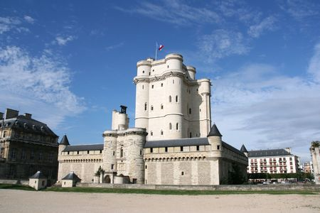 Chateau de Vincennes in Paris, France. Old fortress with French national flag.
