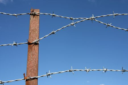 prison fence: Prison fence - old, rusty barbed wire. Jail security.