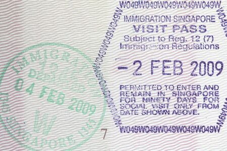 Stamps from Singapore border in a Polish passport photo