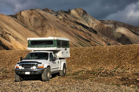 felsic: Beautiful mountains in Iceland. Famous volcanic area with rhyolite rocks - Landmannalaugar. Off-road recreational vehicle. Camper jeep. Stock Photo