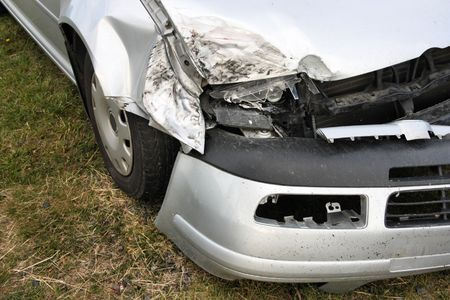 crashed: Crashed car front. Effects of drunk driving - traffic accident. Smashed vehicle.