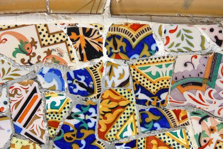 guell: Colorful mosaic in Antoni Gaudis Park Guell - Barcelona detail. Artistic background texture of trencadis. Stock Photo