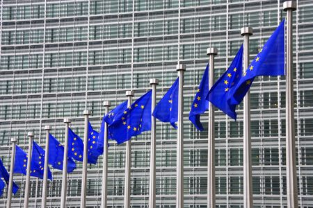 European Union flags. In the background - Berlaymont Building in Brussels, Belgium. Headquarters of the European Comission. Stock Photo - 5582658