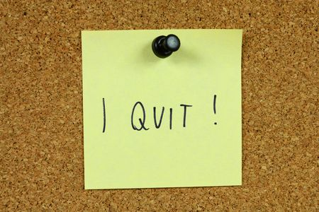 dissatisfaction: Yellow small sticky note on an office cork notice board. Unemployment and job crisis concept. Looking for a new career.