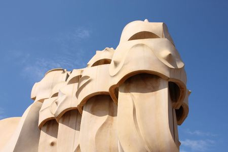 Beautiful modernisme architecture by Antoni Gaudi - famous chimneys of Casa Mila or La Pedrera in Eixample district. Landmark of Barcelona, Catalonia, Spain. photo