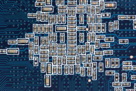 Modern electronic circuit board full of small capacitors. Electronics industry. Stock Photo - 5894770