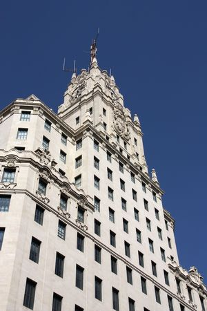 Beautiful decorative old building at Gran Via in Madrid, Spain photo