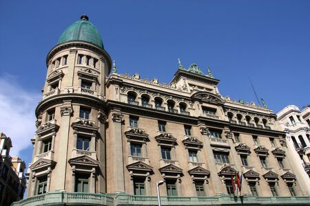 Beautiful decorative old building at Gran Via in Madrid, Spain photo