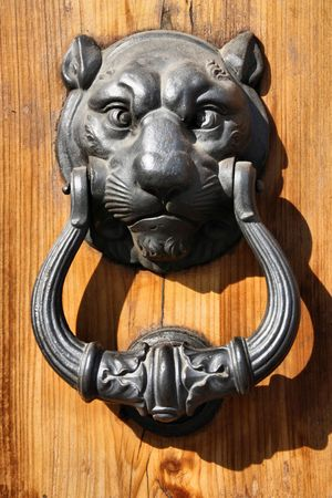 Lion head - vintage iron door knocker in Florence, Italy photo
