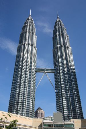 twin tower: Petronas Towers - famous landmark of Kuala Lumpur, Malaysia. Second and third tallest building in the world, as of 2009.