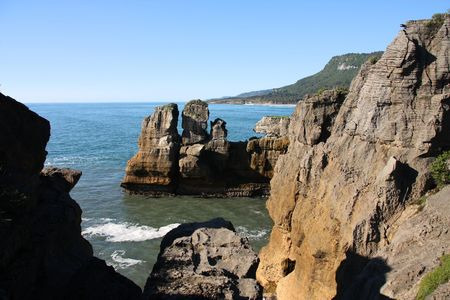 natural landmark: Famous natural landmark in Paparoa National Park - Punakaiki or Pancake Rocks in New Zealand Stock Photo