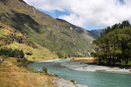 Mount Aspiring National Park in New Zealand. Glacial river. photo