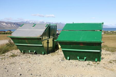 Large garbage dumpsters in Snaefellsnes peninsula, Iceland. Green refuse containers. photo