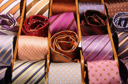 Shopping for elegant dressing accessories. Colorful ties at a shop in Italy. Clothes selection in a store.