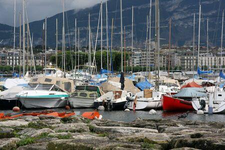 Marina in Geneva, Switzerland. Anchored yachts, sailboats and motorboats. photo