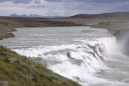 Gullfoss - famous waterfall in Icelandic area called Golden Circle. Rainbow on river Hvita. photo
