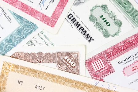 Old stock certificates. American companies shares. Vintage scripophily objects.