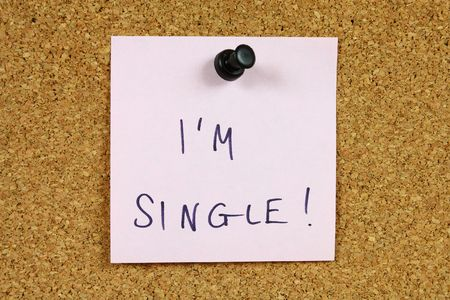 Pink sticky note pinned to an office notice board. I'm single - dating and romance message. Stock Photo - 6244595
