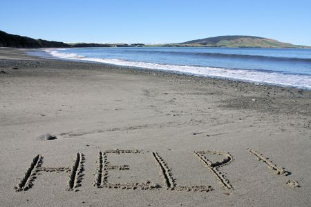 castaway: Help message on a beach in New Zealand