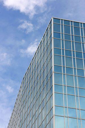 highriser: Skyscraper abstract in Geneva, Switzerland. Modern architecture exterior. Blue sky. Stock Photo