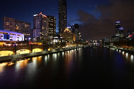 Melbourne night view. Beautiful city of skyscrapers. Yarra River. The prominent building is Eureka Tower, which is the worlds tallest residential tower when measured to its highest floor. photo