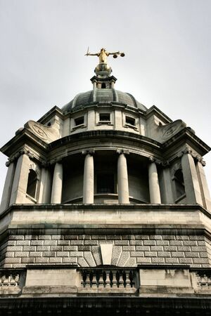 justice statue: Old Bailey, Central Criminal Court in London, England. Justice statue atop the dome. Stock Photo