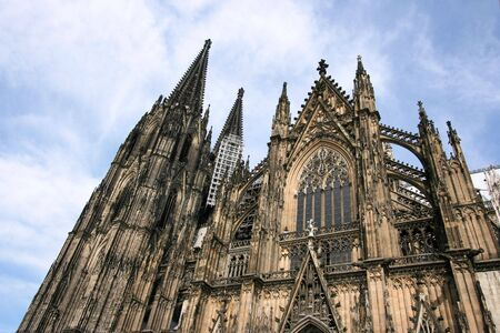 archbishop: Cologne cathedral of Saint Peter and Mary exterior. Famous church in Germany. Seat of Archbishop. UNESCO World Heritage Site.