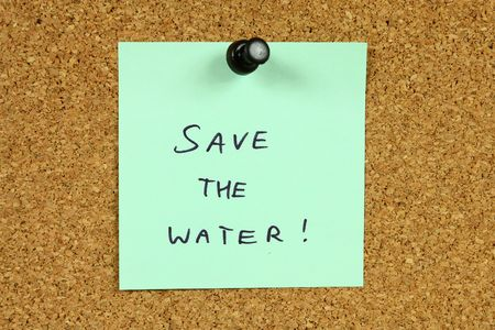 Green sticky note pinned to an office notice board. Save the water - environmental conservation and water saving info. Stock Photo - 6311786