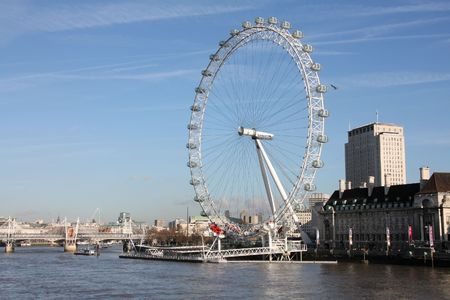 voted: LONDON - JANUARY 20: Famous London Eye and Thames River on January 20, 2009 in London. It was voted top tourist hotspot in the UK by Best of Britain & Ireland 2009.