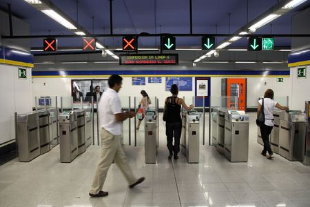 longest: MADRID - SEPTEMBER 3: Metro station entrance turnstiles on September 3, 2009 in Madrid. Madrid Metro is among seven longest metro systems in the world.