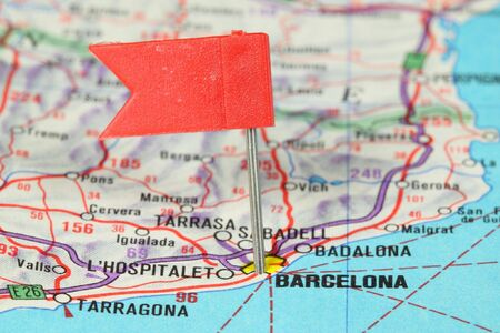 Barcelona - famous city in Spain. Red flag pin on an old map showing travel destination. photo