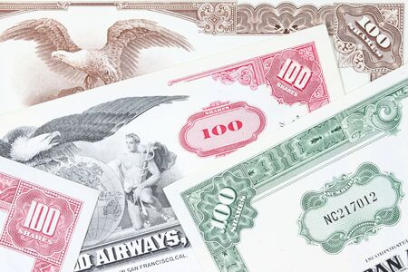 Corporate investing. Old stock share certificates from 1950s-1970s (United States). Vintage scripophily objects. photo