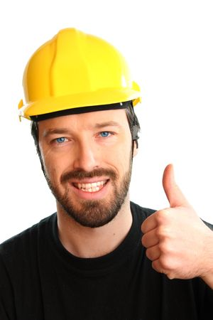 Construction worker in yellow hard hat. Happy caucasian male in his 20s. Young man portrait with thumbs up. photo
