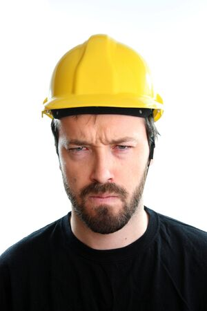 yellow hard hat: Construction worker in yellow hard hat. Angry caucasian male in his 20s. Young man portrait. Stock Photo