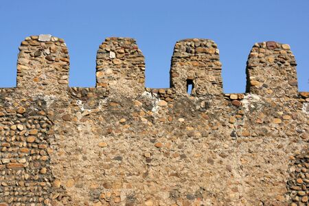 crenellated: Pebble crenellated wall - old city walls in Leon, Castilla, Spain Stock Photo