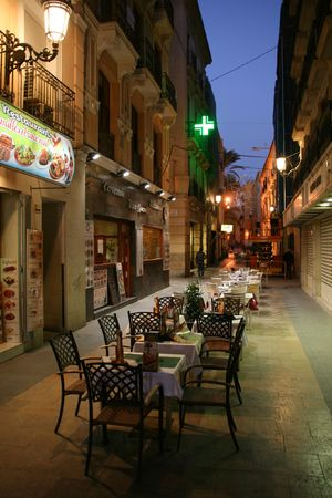 ALICANTE - NOVEMBER 24: Night view of quaint old town streets on November 24, 2008 in Alicante, Spain. Alicante is the main city in Costa Blanca, regarded for its night life.