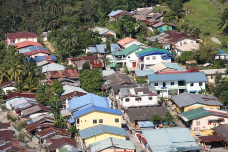 Aerial view of a poor neighborhood in Kuala Lumpur, Malaysia. Housing district on the edge of rainforest jungle. photo