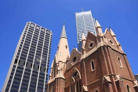 wesley: Perth, Australia. Abstract view of contrast between old and modern architecture. Wesley Church in foreground, skyscraper buildings in background.