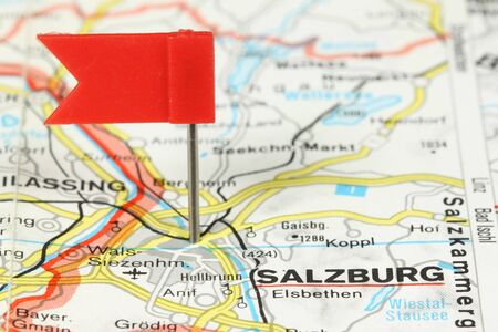 Salzburg - famous city in Austria, Europe. Red flag pin on an old map showing travel destination. photo